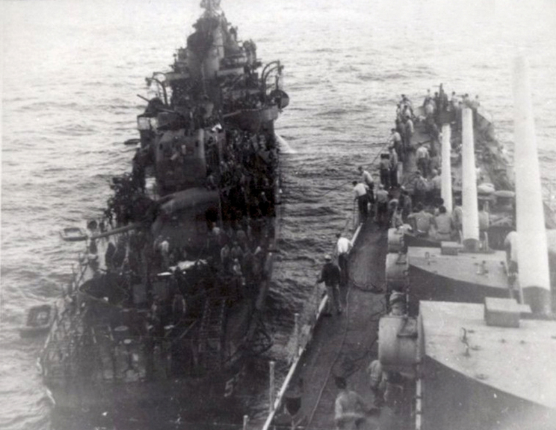 USS_Haggard_(DD-555)_is_assisted_by_USS_San_Diego_(CL-53),_after_being_hit_by_a_kamikaze_off_Okinawa_on_29_April_1945.jpg